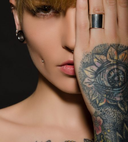 Young,Blonde,With,A,Tattoo,On,Body,,Dark,Background
